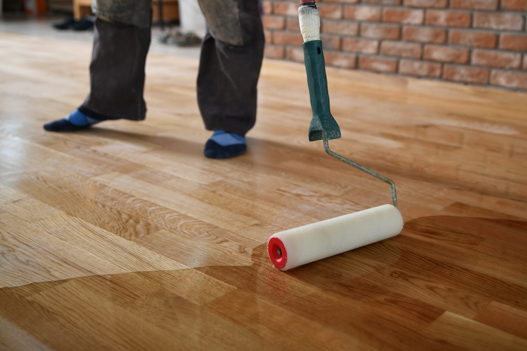 Timber floor installer in Sydney lacquering the floor