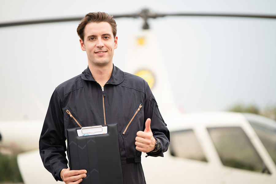 Young man getting a helicopter pilot training