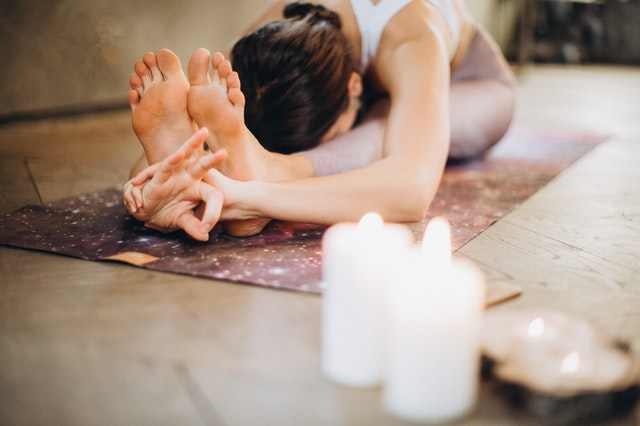 Woman practicing her yoga online learning course