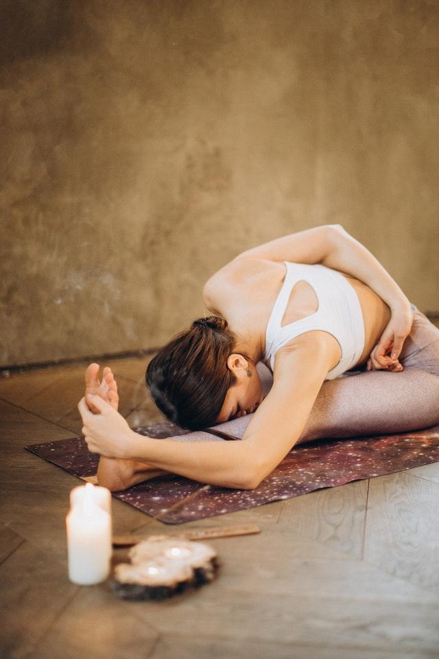 Woman while doing a yoga pose