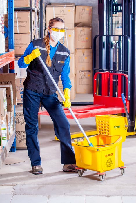 Woman offering commercial cleaning services in Sydney