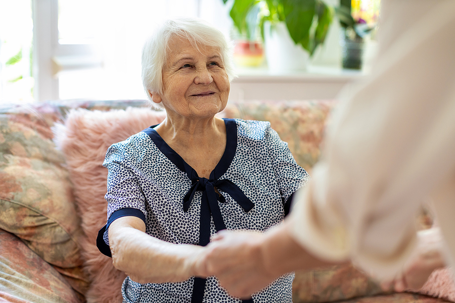 Old woman inquiring about aged care financial planning
